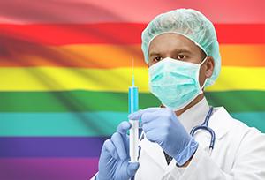 Doctorwithsyringeinhandsandflagonbackgroundseries-LGBTpeople